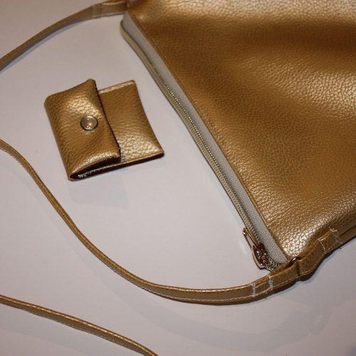 Goldene Handtasche Tampontasche